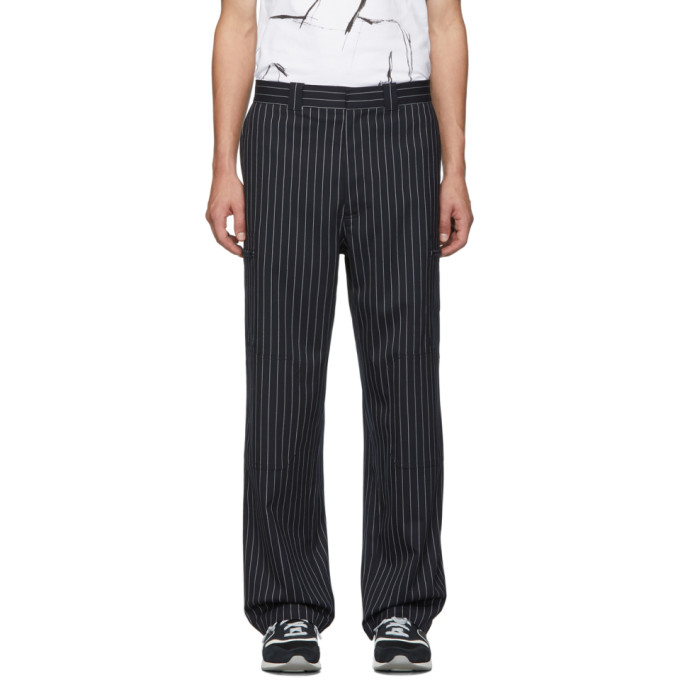 Navy Pinstripe Stretch Wool Trousers by Jw Anderson