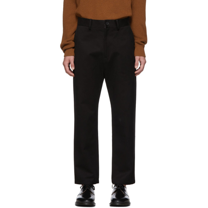 Black Tapered Flat Front Trousers by Studio Nicholson