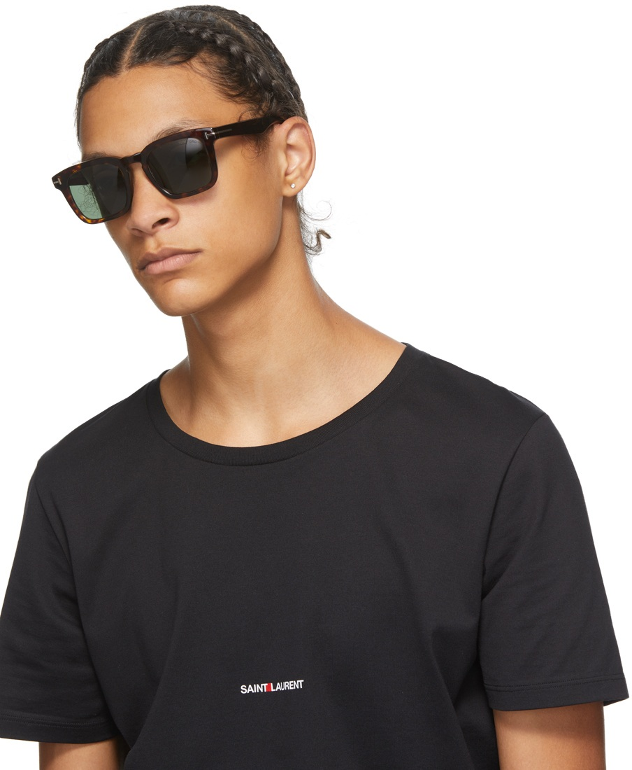 stylish sunglasses placed on wooden table