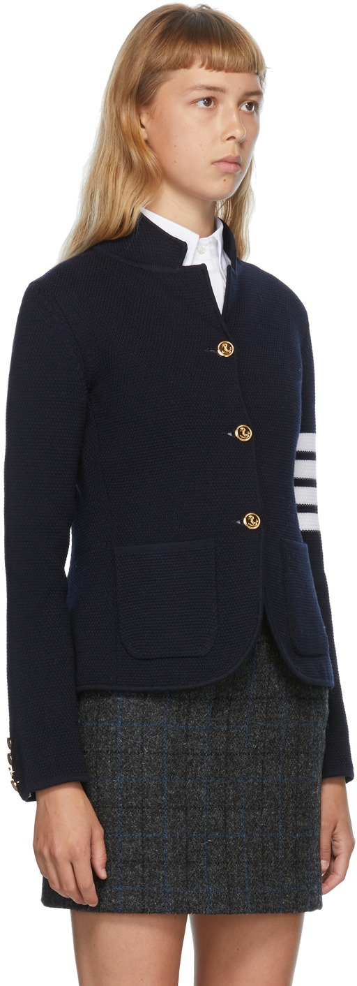 https://img.ssensemedia.com/images/b_white,g_center,f_auto,q_auto:best/202381F057016_2/thom-browne-navy-link-stitch-4-bar-classic-blazer.jpg