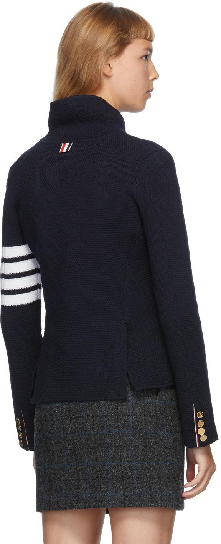 https://img.ssensemedia.com/images/b_white,g_center,f_auto,q_auto:best/202381F057016_3/thom-browne-navy-link-stitch-4-bar-classic-blazer.jpg