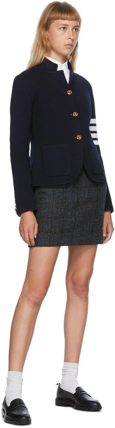 https://img.ssensemedia.com/images/b_white,g_center,f_auto,q_auto:best/202381F057016_4/thom-browne-navy-link-stitch-4-bar-classic-blazer.jpg
