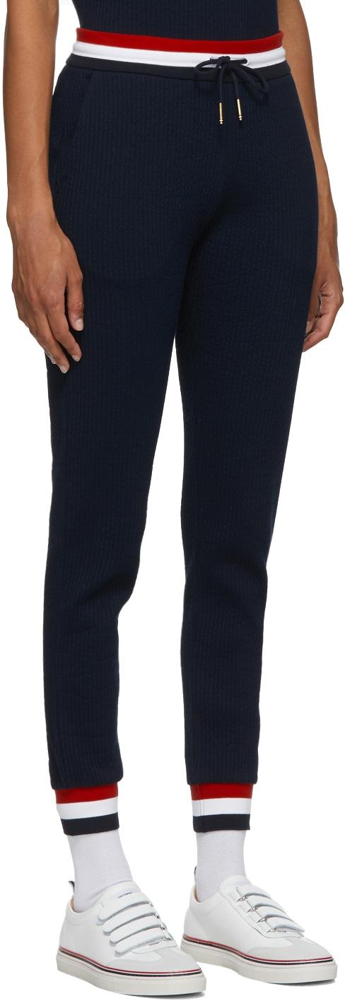 https://img.ssensemedia.com/images/b_white,g_center,f_auto,q_auto:best/202381F086031_2/thom-browne-navy-seersucker-tricolor-waistband-lounge-pants.jpg