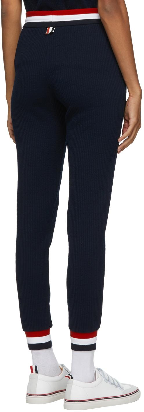 https://img.ssensemedia.com/images/b_white,g_center,f_auto,q_auto:best/202381F086031_3/thom-browne-navy-seersucker-tricolor-waistband-lounge-pants.jpg