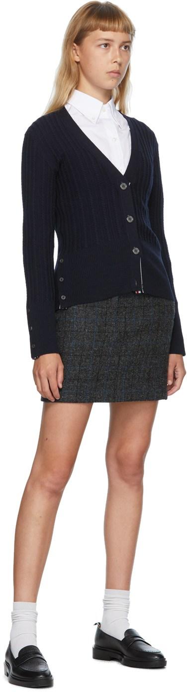 https://img.ssensemedia.com/images/b_white,g_center,f_auto,q_auto:best/202381F095057_4/thom-browne-navy-wool-v-neck-cardigan.jpg