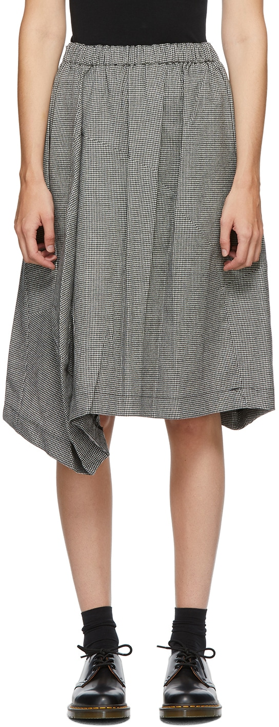 https://img.ssensemedia.com/images/b_white,g_center,f_auto,q_auto:best/202671F092010_1/comme-des-garcons-comme-des-garcons-black-and-white-wool-houndstooth-midi-skirt.jpg