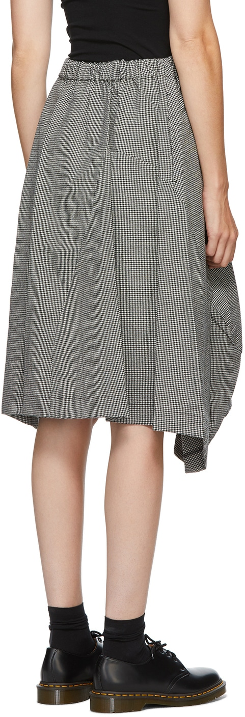 https://img.ssensemedia.com/images/b_white,g_center,f_auto,q_auto:best/202671F092010_3/comme-des-garcons-comme-des-garcons-black-and-white-wool-houndstooth-midi-skirt.jpg