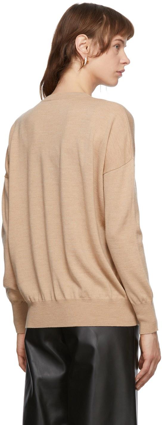 https://img.ssensemedia.com/images/b_white,g_center,f_auto,q_auto:best/202677F096144_3/loewe-beige-embroidered-anagram-sweater.jpg