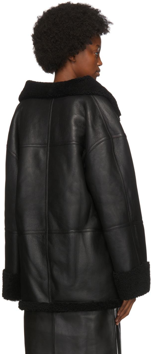https://img.ssensemedia.com/images/b_white,g_center,f_auto,q_auto:best/202771F062124_3/toteme-black-shearling-menfi-jacket.jpg