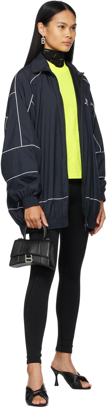 https://img.ssensemedia.com/images/b_white,g_center,f_auto,q_auto:best/211342F063030_4/balenciaga-navy-bb-zip-up-jacket.jpg