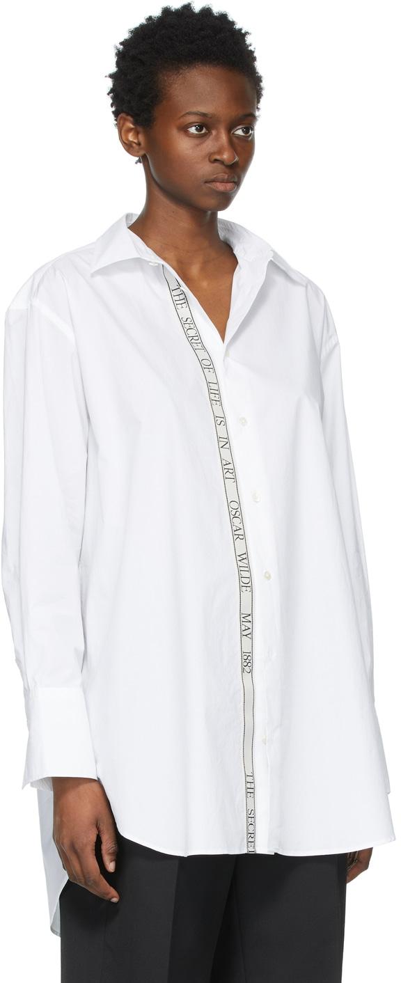 https://img.ssensemedia.com/images/b_white,g_center,f_auto,q_auto:best/211477F109082_2/jw-anderson-white-oversized-oscar-wilde-tape-shirt.jpg