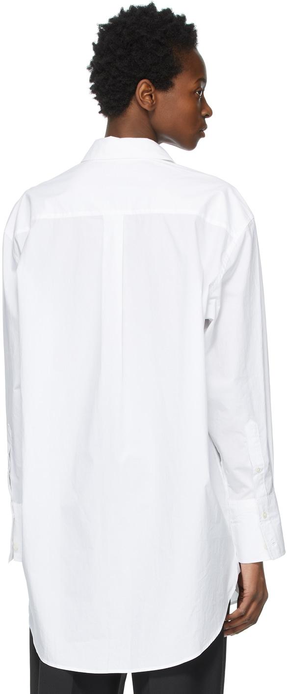 https://img.ssensemedia.com/images/b_white,g_center,f_auto,q_auto:best/211477F109082_3/jw-anderson-white-oversized-oscar-wilde-tape-shirt.jpg