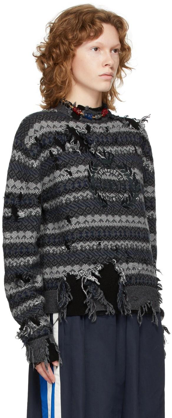 https://img.ssensemedia.com/images/b_white,g_center,f_auto,q_auto:best/212342F096001_2/balenciaga-grey-destroyed-fair-isle-sweater.jpg