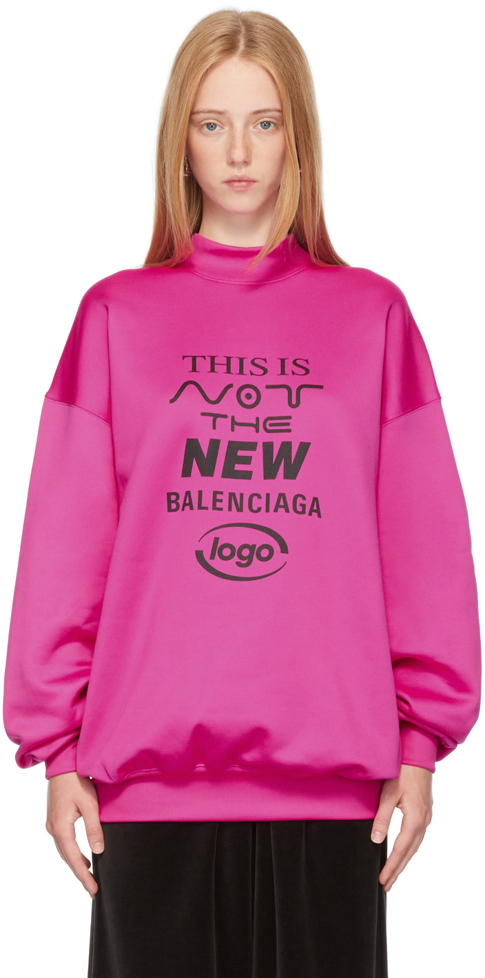 https://img.ssensemedia.com/images/b_white,g_center,f_auto,q_auto:best/212342F098025_1/balenciaga-pink-this-is-not-the-new-logo-sweatshirt.jpg