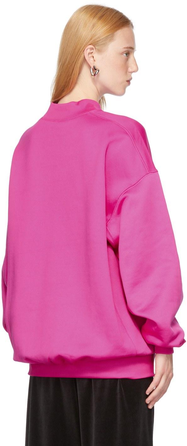 https://img.ssensemedia.com/images/b_white,g_center,f_auto,q_auto:best/212342F098025_3/balenciaga-pink-this-is-not-the-new-logo-sweatshirt.jpg