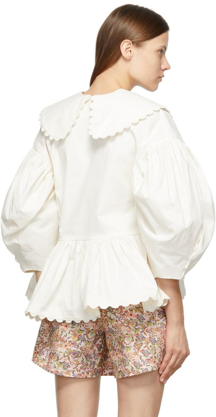 https://img.ssensemedia.com/images/b_white,g_center,f_auto,q_auto:best/212593F107006_3/kika-vargas-off-white-shona-blouse.jpg