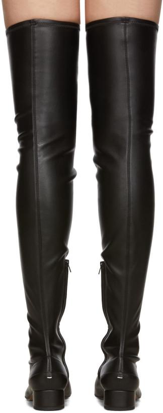 https://img.ssensemedia.com/images/b_white/c_scale,h_820/f_auto,dpr_1.0/192168F115003_4/maison-margiela-black-high-tabi-boots.jpg